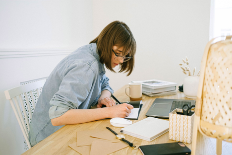 Woman working in small home office